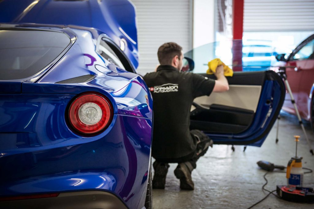 Window Tints being fitted on a Ferrari F12 by Expression Automotive in Leeds